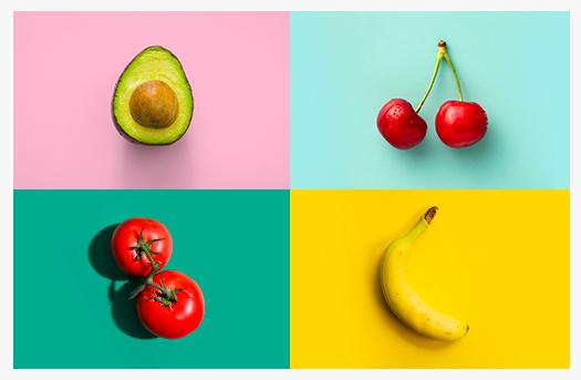 Pour souligner l'Annéée internationale des fruits & l,égumes, un avocat, des cerises, des tomates et une banane.
